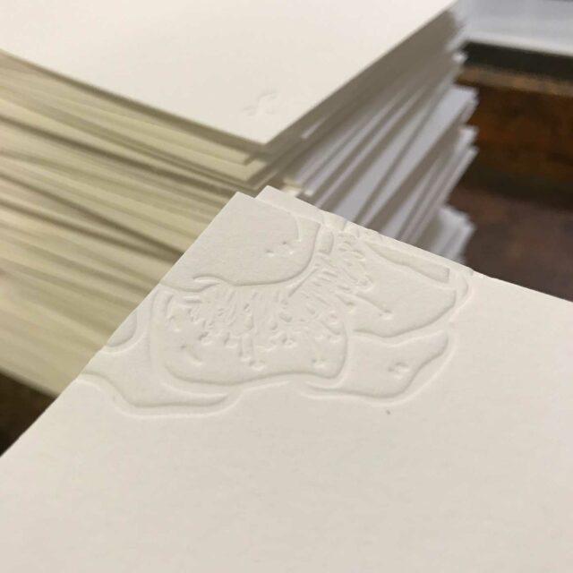 Letterpress design on corner of page